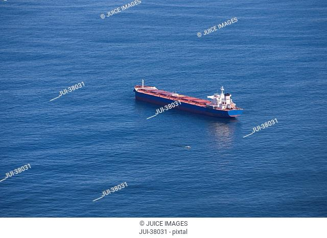 Aerial view of cargo ship at sea