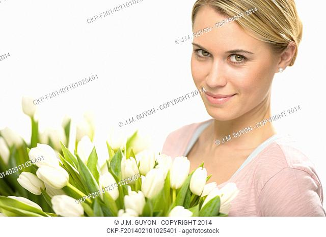 Romantic woman with bouquet of white tulip flowers