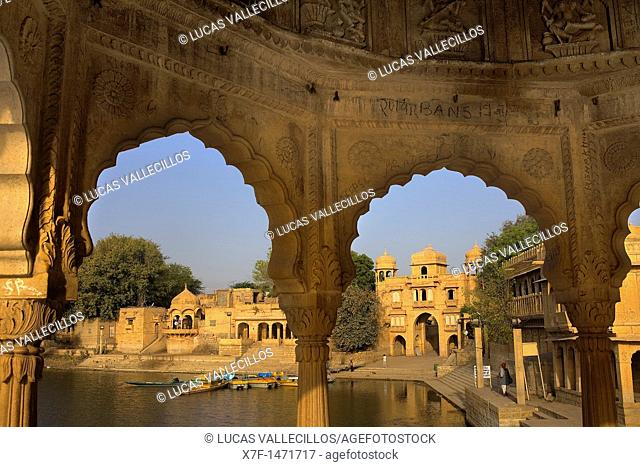 Gadi Sagar, the tank was once the water supply of the city and is surrounded by small temples and shrines,in background at right Tilon ki Pol archway,Jaisalmer