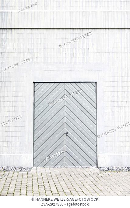 A grey door in a white wall in Tallinn, Estonia, Europe