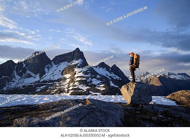 Female Hiker standing on rock overlooking Lynn Canal & Berner's Bay near Juneau Alaska