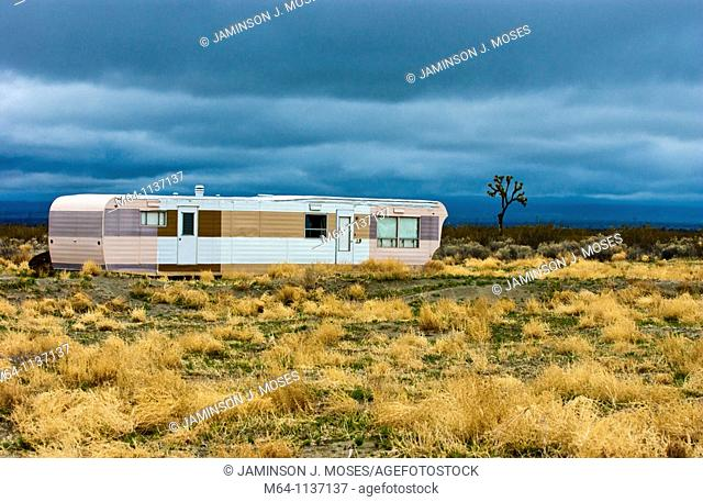 Desolate and abandoned mobile home trailer in the southern California desert