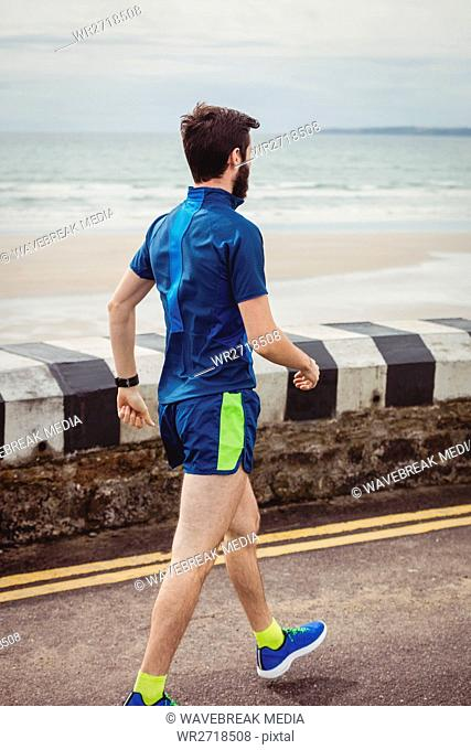 Athlete walking on the road