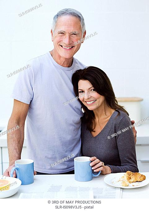 Mature couple having breakfast