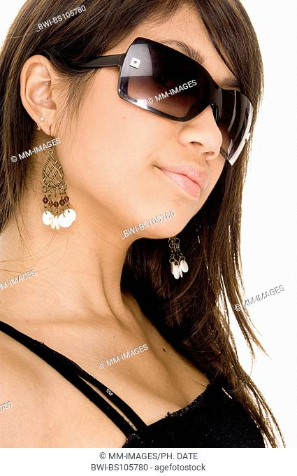 A cute young asian woman with black sunglasses looking cool