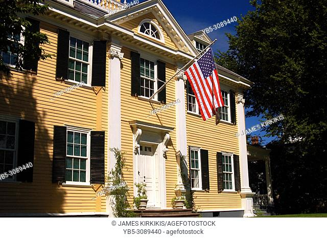 An American flag hangs from the Longfellow House, once home to writer Henry Wadsworth Longfellow, in Cambridge, Massachusetts