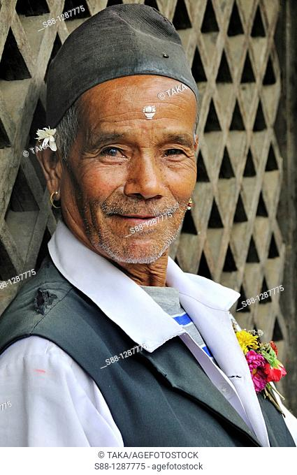 The man standing at the market at Durbar Square