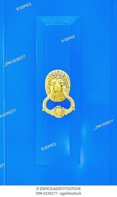 blue wooden door with lion's head and door knocker, lagos, algarve, portugal