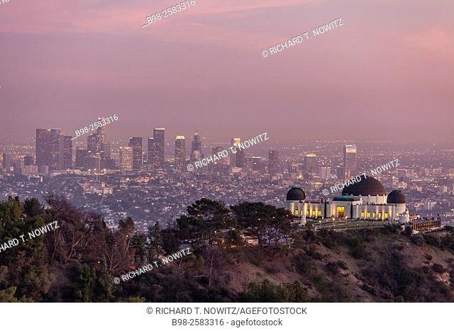 Griffith Park Observatory and the downtown Los Angeles skyline at night, California, USA