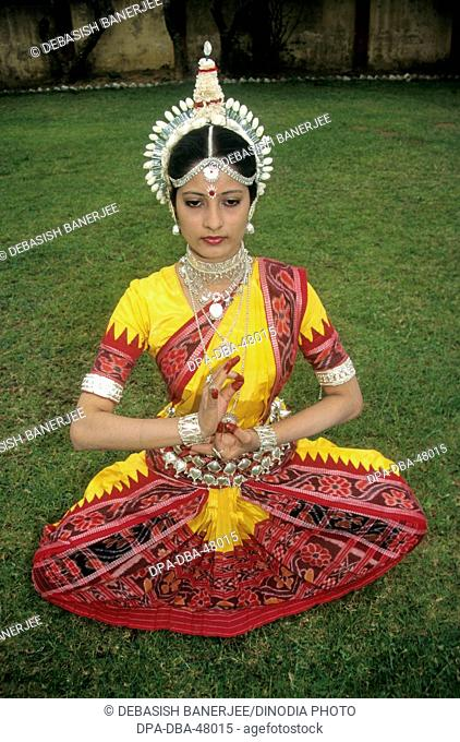 woman performing indian classical odissi dance ; india ; MR697