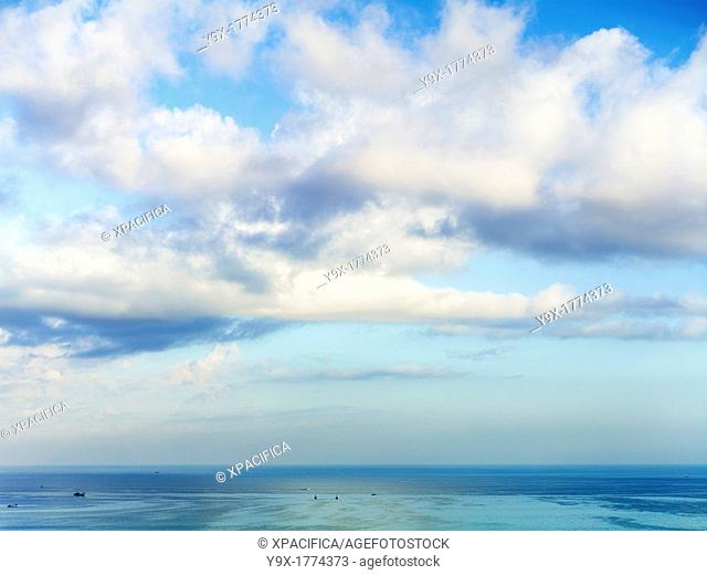 Fluffy clouds over the ocean in Bali, Indonesia