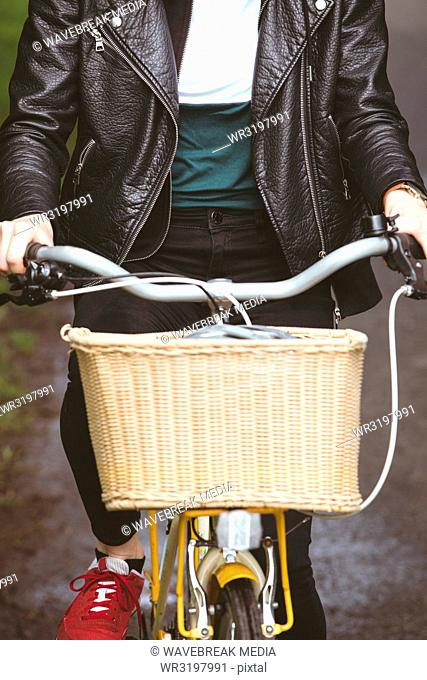 Woman in jacket riding cycle