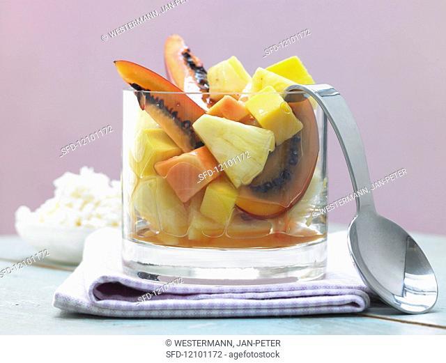 Exotic fruit salad with piña colada granita