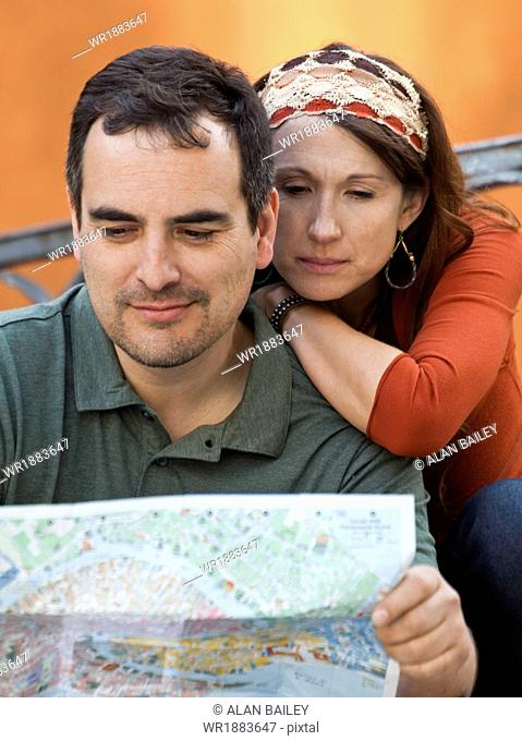 Italy, Venice, Couple with map, sightseeing in city