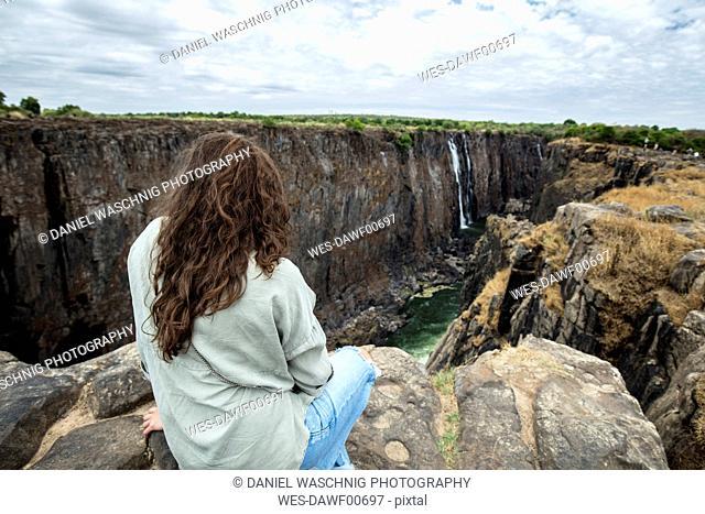 Zimbabwe, woman watching Victoria Falls