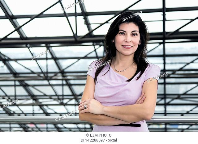 Portrait of a mature business woman in the atrium of an office building; Edmonton, Alberta, Canada