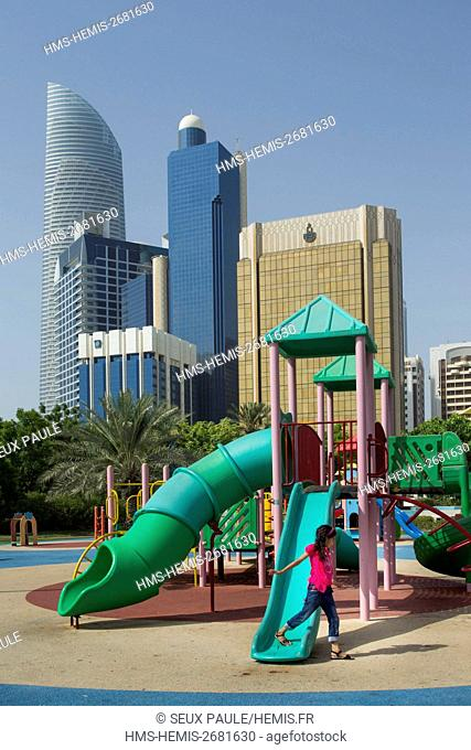 United Arab Emirates, Abu Dhabi, skyscrapers on Corniche with kids garden
