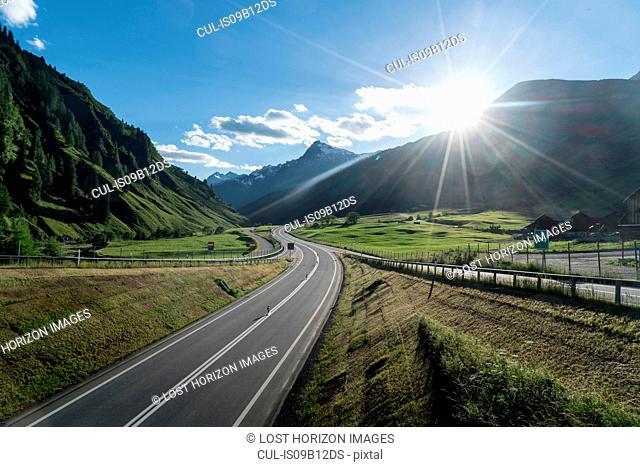 Empty highway at sunset, Splugen, Canton Graubunden, Switzerland