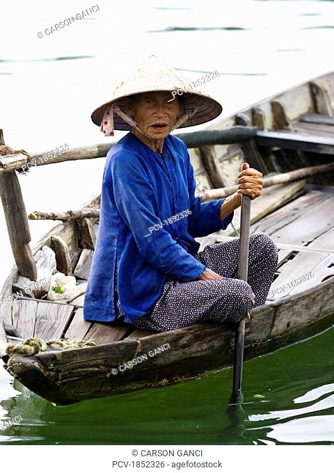 Woman on a small boat in Vietnam