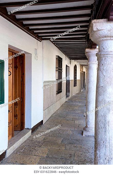 Pillars and covered walkway under balcony in town square of Almagro in Castilla-La Mancha, Spain, Europe