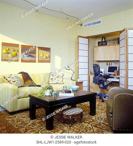 OFFICES-HOMES - Den with computer area behind folding fabric screens, light yellow walls, yellow stripped sofa, oriental area rug