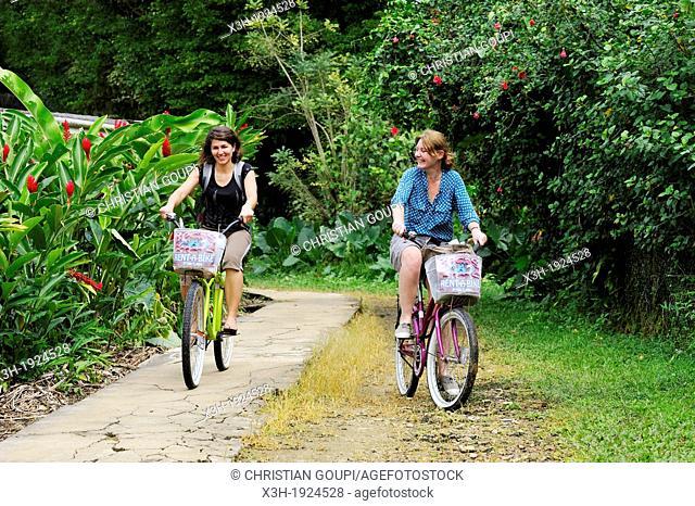 young women going for bike ride at Colon Island, Bocas del Toro Archipelago, Republic of Panama, Central America
