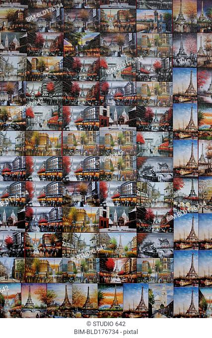 Collage of souvenir postcards on gift shop wall, Paris, Ile-de-France, France