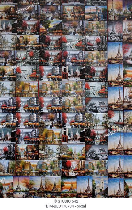Collage of souvenir postcards on gift shop wall, Paris, Ile-de-France, France