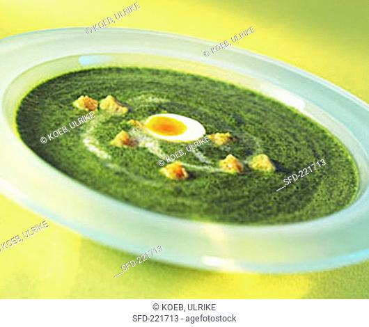 Ramsons (wild garlic) soup with quail's egg and croutons