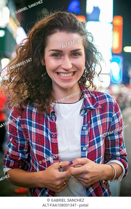Young woman in Times Square, New York City, New York, USA