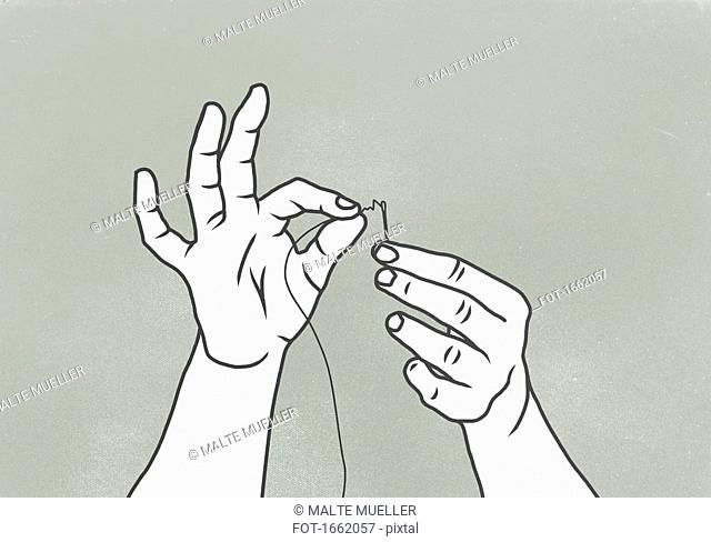 Cropped image of woman threading needle against gray background