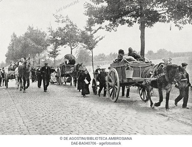 Villagers fleeing before the German advance guard, Belgium, World War I, photograph by the Daily Mirror, from L'Illustrazione Italiana, Year XLI, No 37