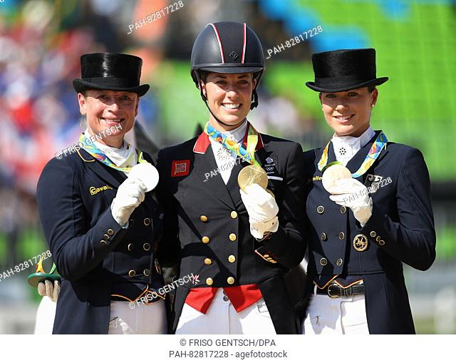 (L-R) Silver medalist Isabell Werth (Weihegold) of Germany, Gold medalist Charlotte Dujardin (Valegro) of Great Britain and Bronze medalist Kristina...