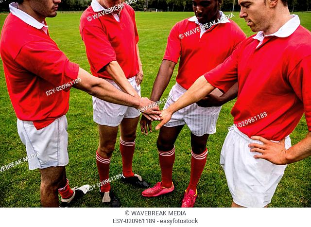 Rugby players putting hands together