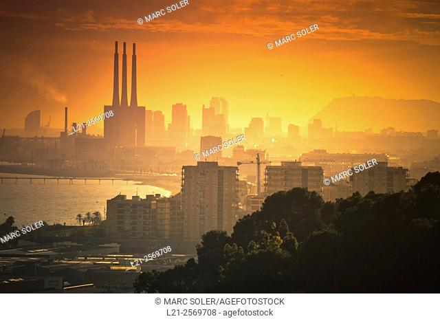 Cityscape of Barcelona from Montgat at sunset. You can see highlights among many buildings, Badalona buildings, sea, Besos electric power plant