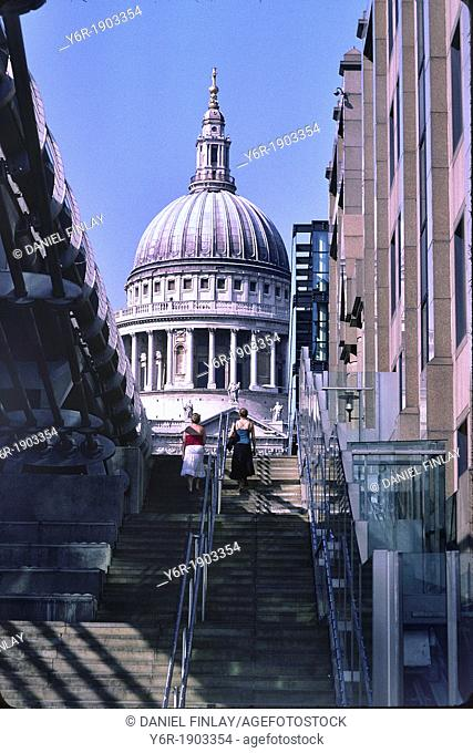 Steps leading from the banks of the River Thames in London, England, up to the Millenium Bridge seen on the left and the Peter's Hill pedestrian walkway up to...