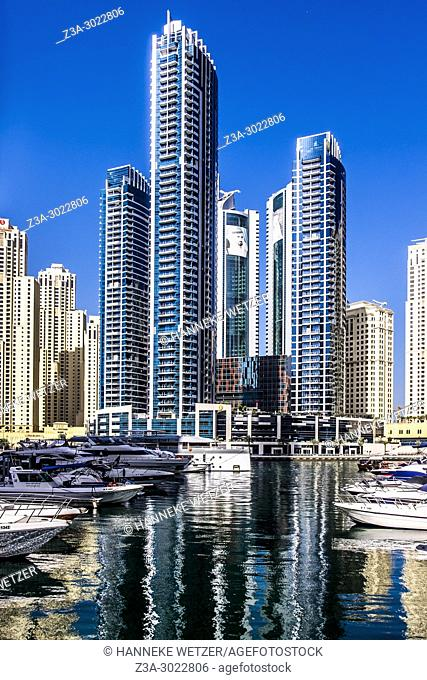 Vew of Dubai Marina promenade with modern towers in Dubai
