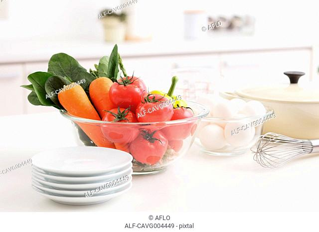 Fresh Vegetables And Eggs In Bowl With Plates And Wire Whisk