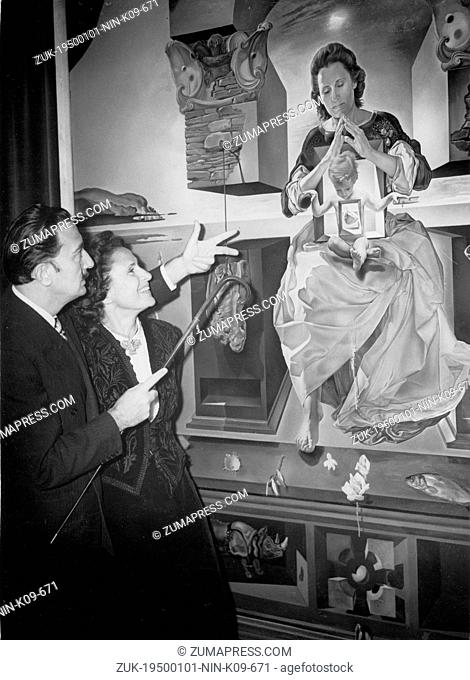 Jan. 1, 1950 - Paris, France - Spanish artist SALVADOR DALI, one of the most important painters of the 20th century, pictured with his wife GALA in front of one...