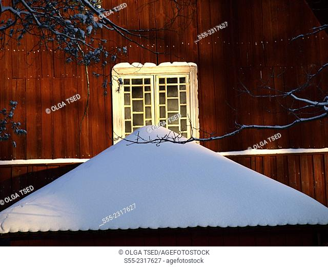 Window and little roof covered with snow. Lappeenranta, Finland