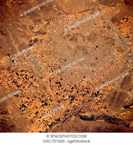 Street and highway grid patterns in metropolitan Phoenix are visible in this photograph. The population of this arid, hot region grew rapidly in the 1960s and...