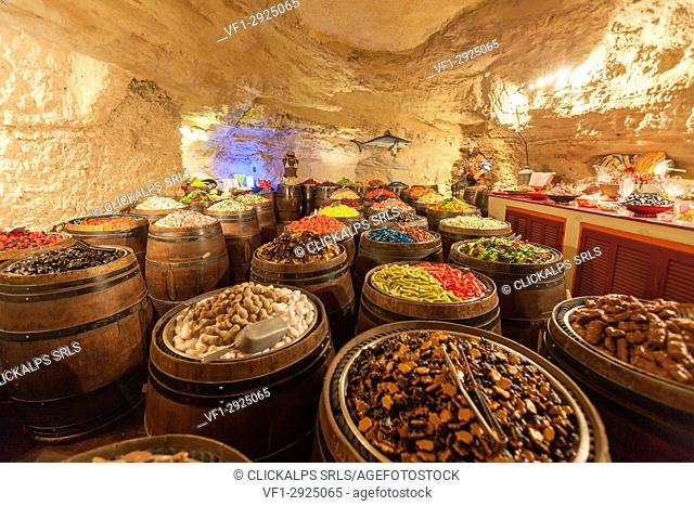 The interior of sweet shop built in a rock cave. Bonifacio, Corsica, France Europe