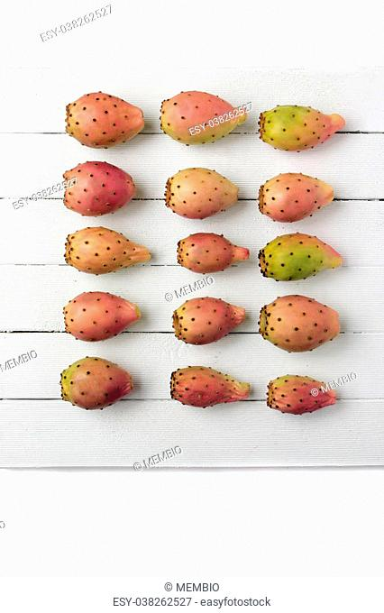 View of a Opuntia ficus-indica cactus fruits on a white wooden background
