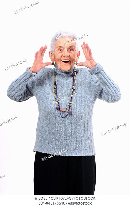 senior woman with expression of forgetfulness or surprise on white background