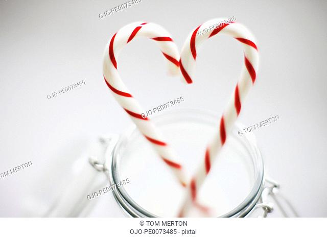 Close up of candy canes forming heart-shape