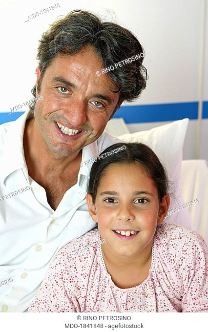 Italian director Giulio Base posing smiling beside his daughter and actress in the fiction Cristiana in a photo shooting shooted on the set of the TV fiction...