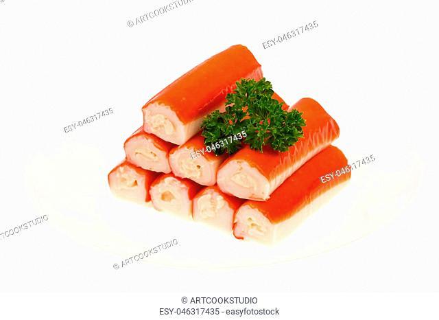 Crab sticks surimi stuffed with cheese on white background. Studio Photo