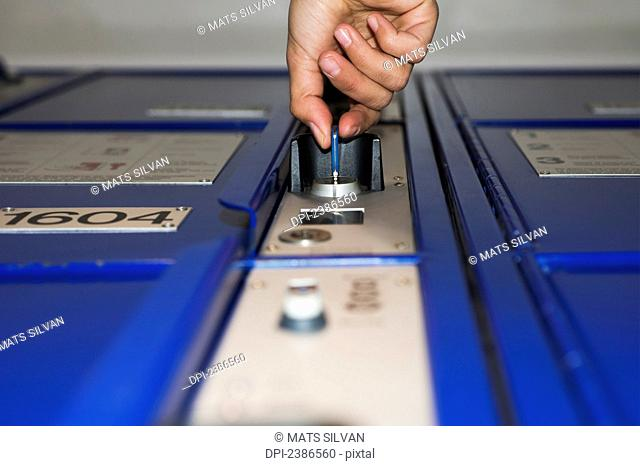 A key opening a lock to a locker in a train station; Zurich, Switzerland