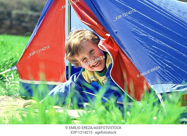 Little boy and tent