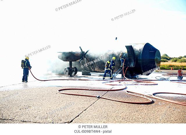 Firemen putting out fire on old training aeroplane, Darlington, UK